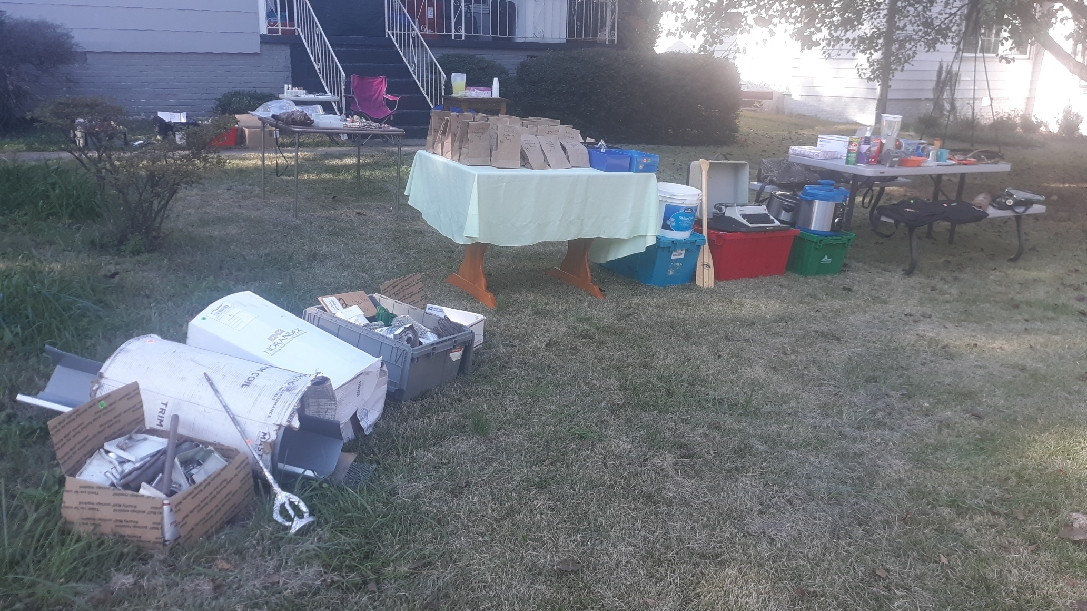 Yard sale with clothes, shoes, kitchen, jewelry, makeup, tools, mystery bags, gutter supplies.